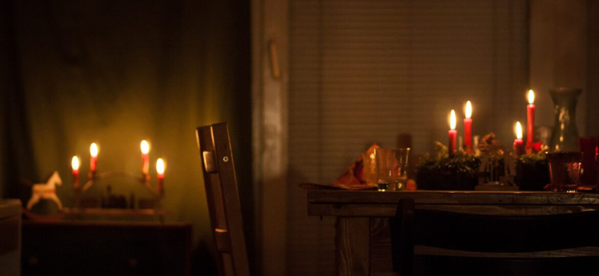 lighted candles on brown wooden table